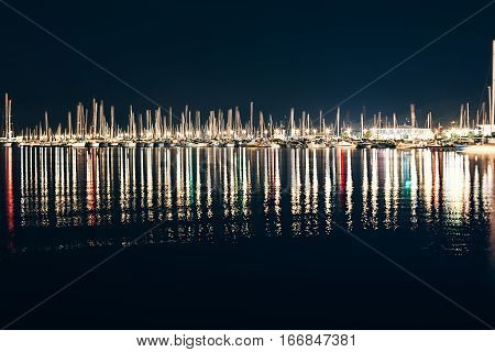Yachts And Boats In Marina Of La Spezia At Night With Reflection In Wate