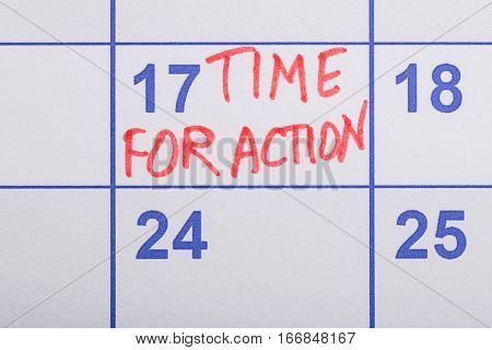Close-up Of Time For Action In Red Text Written On The Calendar