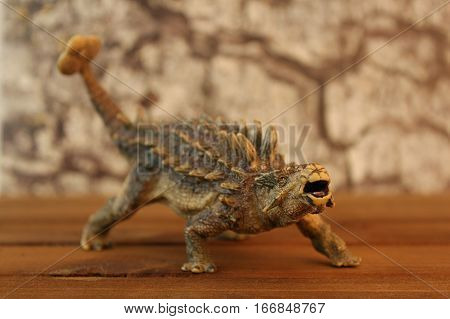 Photo of plastic toy Ankylosaurus dinosaur looking scary