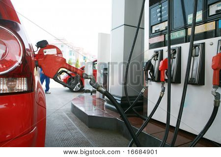 close-up of  refilling the car with a gas pump