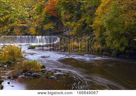 River Almond With Waterfall At Autumn Time