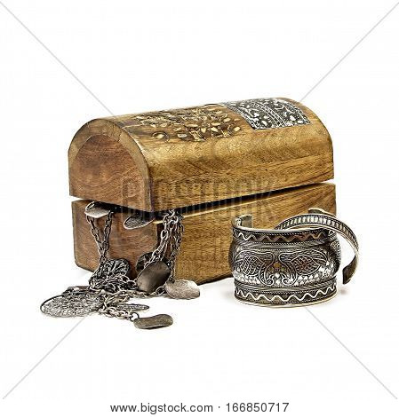 jewelery box and silver bracelets on a white background