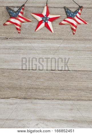 USA patriotic old flag on a stars with weathered wood background with copy space for your message
