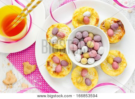 Funny Easter treats for kids - Easter nest cakes with colorful chocolate candy eggs