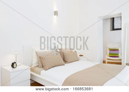 Brightly Lit Bedroom with fresh and clean linens