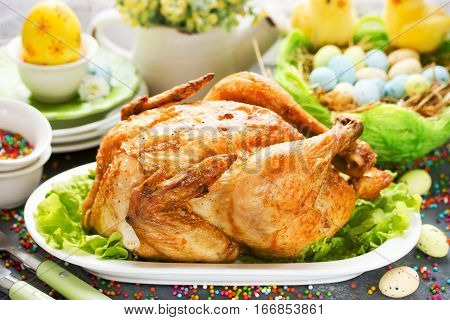 Roasted Easter chicken on festive Easter table