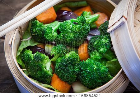 chinese bamboo steam with vegetables and chopstick