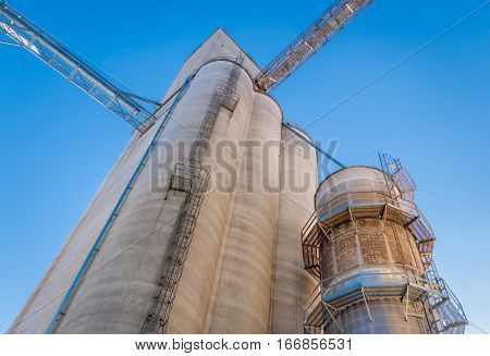 Upward view of grain elevator in the American midwest.