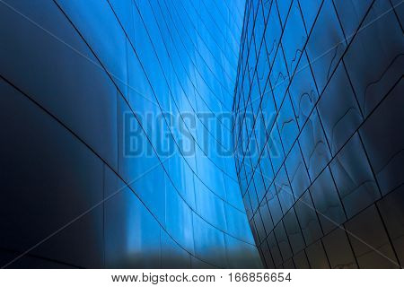 Abstract leading lines on blue converging in center forming circular shape.