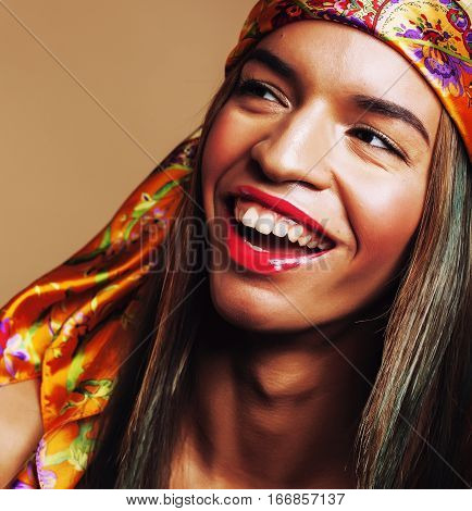 beauty young afro american woman in shawl on head smiling close up