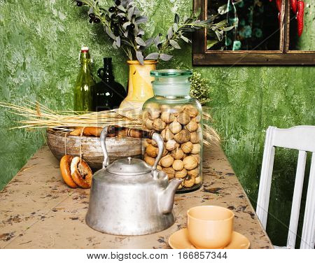 country kitchen with green walls and wood table, rural vintage look