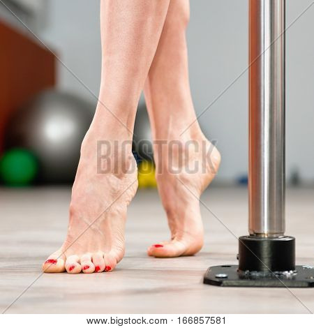 Pole dance fitness detail, toned image, square image