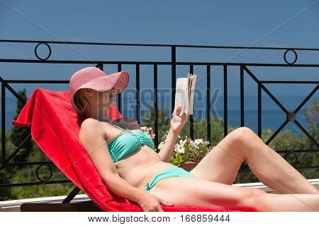 Woman Relaxing On Longue Chair
