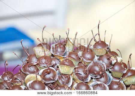 Chocolate covered cherries in street market in street market
