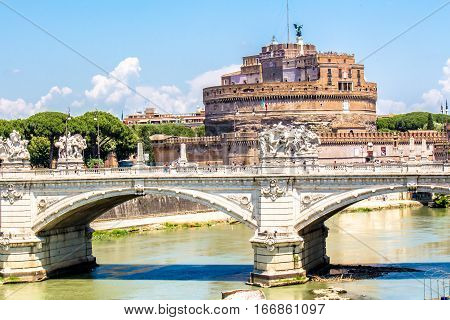 view of Castel Sant'Angelo and the bridge over the Tiber in Rome Italy