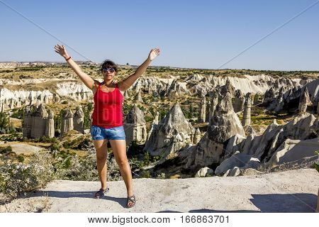 Girl posing against the backdrop of fabulous mountains in Cappadocia in Turkey
