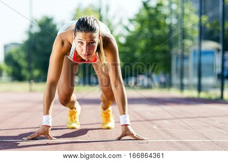 Female Sprinter Getting Ready For The Run