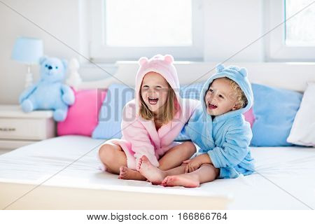Children In Bathrobe Or Towel After Bath