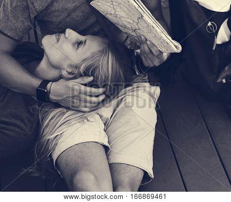 Woman lying on boyfriend's lap traveling
