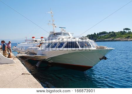 PAXOS, GREECE - JUNE 23, 2014: Joy Cruises hydrofoil ferry Ilida 11 docked at Gaios harbour on the Greek island of Paxos. The 35mtr vessel was built in 1982 in Georgia.