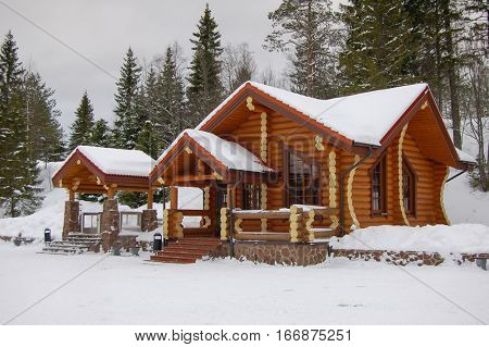 Cottage in snowy winter landscape