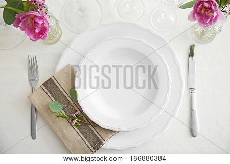 Flower arrangement on table served for wedding dinner