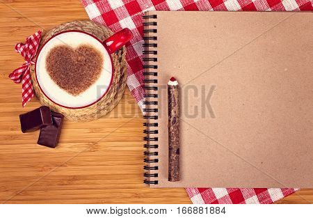Cup Of Coffee On Wooden Table With Blank Paper And Pencil. St. Valentine's Breakfast.