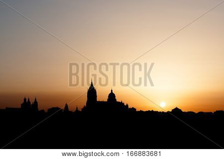 Panoramic view of the Cathedral of Salamanca backlit at dawn
