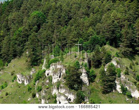 Cross on grassy hill near pottenstein germany