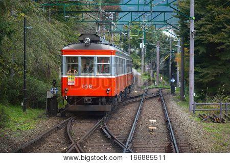HAKONE, JAPAN - NOVEMBER 7, 2016: Train to the volcanic valley of Owakudani in Japan. Owakudani has many active sulphur vents and hot springs in Hakone, Japan.