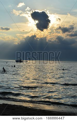 Sunset shining behind clouds over Lake Erie