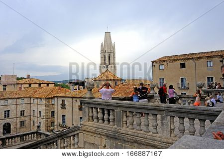 Girona, Spain - August 2, 2014 - Visitors are exploring the histrorical medieval district in Girona