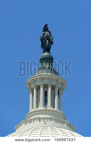 Statue of Freedom on the dome of United State Capitol Building in Washington, District of Columbia, USA.