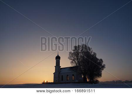 Winter sunrise near the church, fantastic winter nature landscape, wallpaper