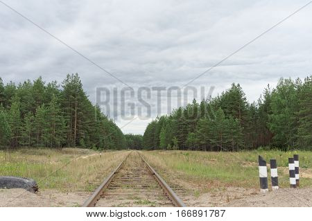 The old railway line in the forest. Russia.