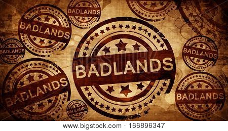 Badlands, vintage stamp on paper background