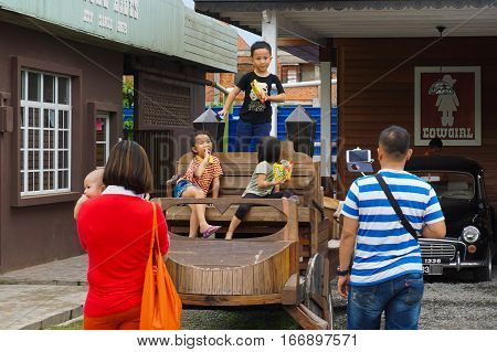 Tuaran,Sabah,Malaysia-Jan 22,2017:Happy family take a photo in Sabandar Leisure Rides,it is Sabah's latest attraction for lovers of the Wild West & new tourist attraction in Sabah Malaysian Borneo