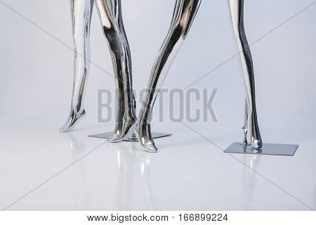 legs of fashion  female mannequins. Metallic mannequin, shinny reflection model