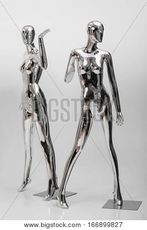 many fashion shiny female mannequins for clothes. Metallic mannequin, shinny reflection model