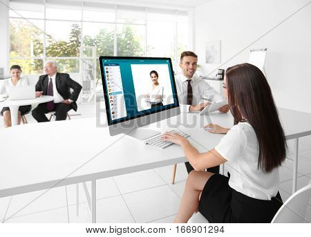 Woman video conferencing with lawyer on computer. Video call and online service concept.