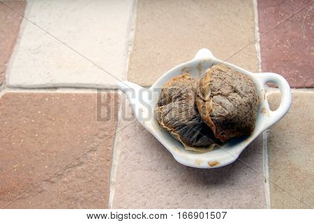 Used Teabags On A Teabag Shaped Plate On A Kitchen Windowsill