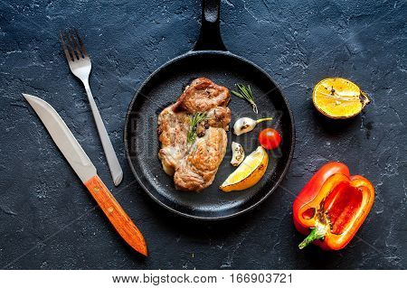 concept cooked steak on dark background top view.