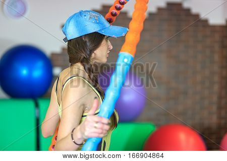 Young Beautiful White Girl In A Yellow And Gray Sports Suit Does Physical Exercises With A Hoop At T