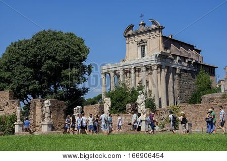 ROME, ITALY - SEPTEMBER 4: Tourists visit House of the Vestal ruins and Temple of Antoninus and Faustina in Roman Forum SEPTEMBER 4, 2016 in Rome, Italy