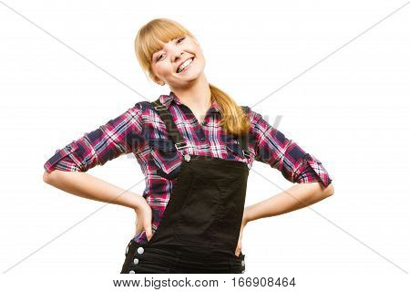 Gardening fahion concept. Smiling attractive woman in pink check shirt and dungarees hands on hips. Isolated background