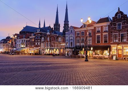 DELFT, NETHERLANDS - JANUARY 3, 2017: Markt square in winter evening. The central market of Delft is one of the largest market squares in Europe, 50?120 yards