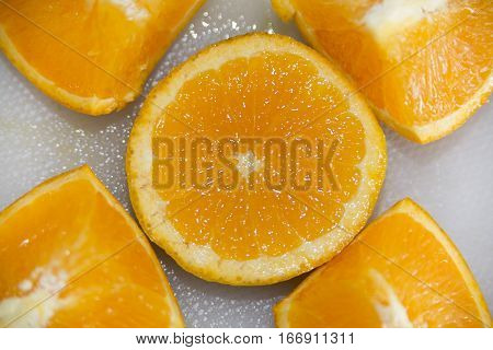 Fresh Orange slice and segments on a white kitchen board
