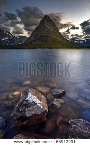 Beauty of sunset on Swifcurrent Lake Glacier National Park