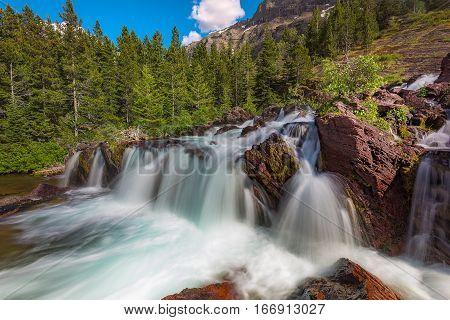 Red Rock Falls at Many Glacier Glacier National Park