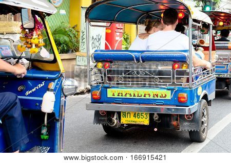 BANGKOK, THAILAND - JANUARY 2, 2017 : Motorized Tricycle on Yaowarat Road,chinatown of Bangkok, The Motorized Tricycle are a popular way to transport in Yaowarat Road.